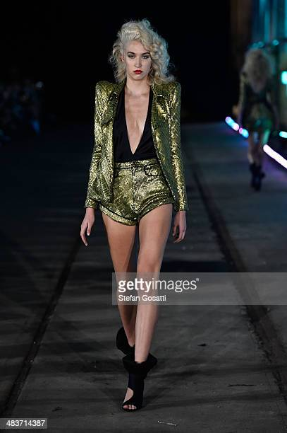A model walks the runway at the Zhivago show during MercedesBenz Fashion Week Australia 2014 at the Paint Shop Building Everleigh Suburban Car...