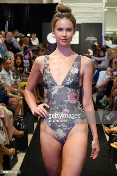 A model walks the runway at the Zimmermann At Miami Swim Week Powered By Art Hearts Fashion At Saks Fifth Avenue on July 16 2018 in Miami Florida