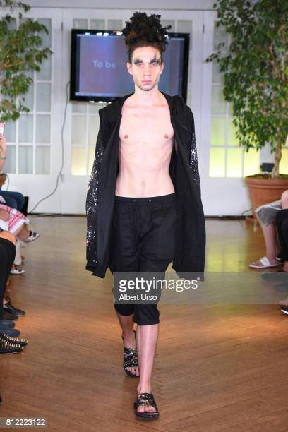 A model walks the runway at To Be Thrill By Edison Lu at New York Fashion Week Men's 2018 on July 10 2017 in New York City