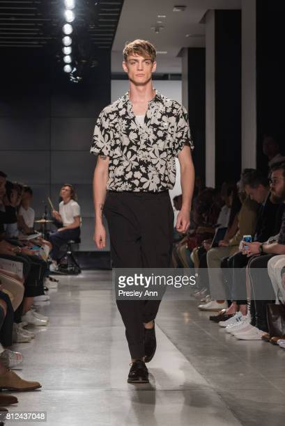 Model walks the runway at Todd Snyder Runway NYFW Men's July 2017 at Cadillac House on July 10 2017 in New York City