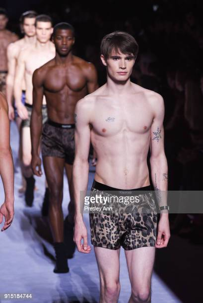 A model walks the runway at Tom Ford Men's February 2018 New York Fashion Week at Park Avenue Armory on February 6 2018 in New York City