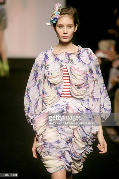 Model walks the runway at Tsumori Chisato Pret a Porter during Paris Womenswear Fashion Week Spring/Summer 2010 at Le Carrousel du Louvre on October...