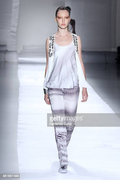 A model walks the runway at Uma Raquel Davidowicz show during Sao Paulo Fashion Week Summer 2014/2015 at Parque Candido Portinari on April 1 2014 in...