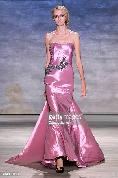 A model walks the runway at Venexiana during MercedesBenz Fashion Week Spring 2015 at The Pavilion at Lincoln Center on September 6 2014 in New York...