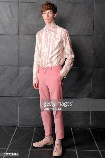 Model walks the runway at Victor Li Ready to Wear Fall/Winter 2019 fashion show during men's New York Fashion Week on February 4, 2019 in New York...