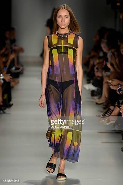 Model walks the runway at Vitorino Campos show during Sao Paulo Fashion Week Summer 2014/2015 at Parque Candido Portinari on April 1, 2014 in Sao...