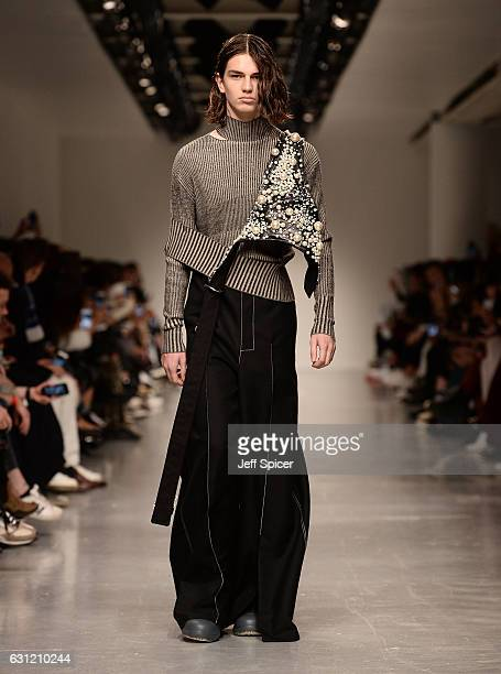 A model walks the runway at Ximon Lee show during London Fashion Week Men's January 2017 collections at BFC Show Space on January 8 2017 in London...