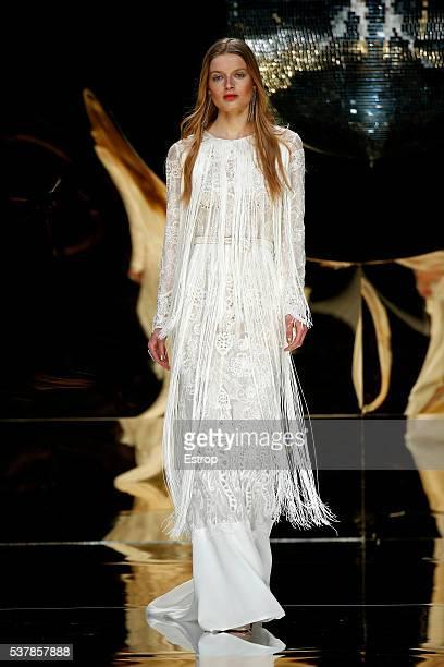 Model walks the runway at Yolan Cris bridal fashion Season 2017 show during 'Barcelona Bridal Fashion Week 2016' on April 27, 2016 in Barcelona,...