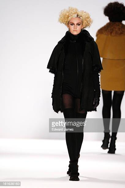 A model walks the runway at Zang Toi during Fall 2013 MercedesBenz Fashion Week at the Stage on February 13 2013 in New York City