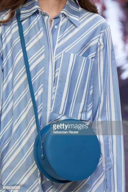 A model walks the runway bag detail at the Holy Ghost show during the MercedesBenz Fashion Week Berlin Spring/Summer 2018 at Heeresbaeckerei on July...