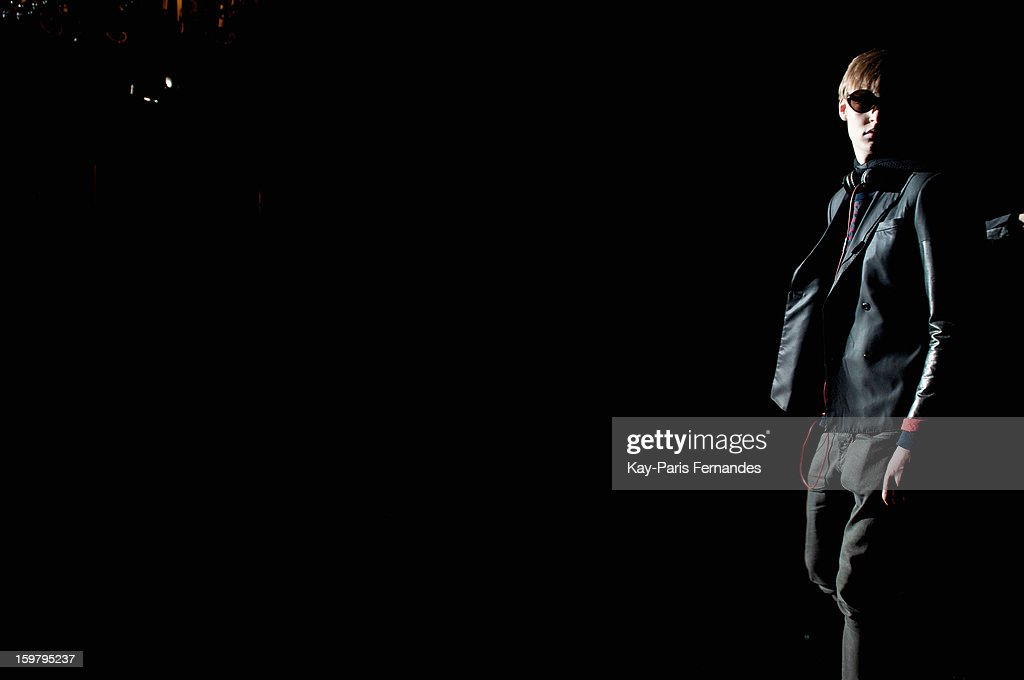 A model walks the runway before the Rynshu Men Autumn / Winter 2013 show as part of Paris Fashion Week on January 20, 2013 in Paris, France.