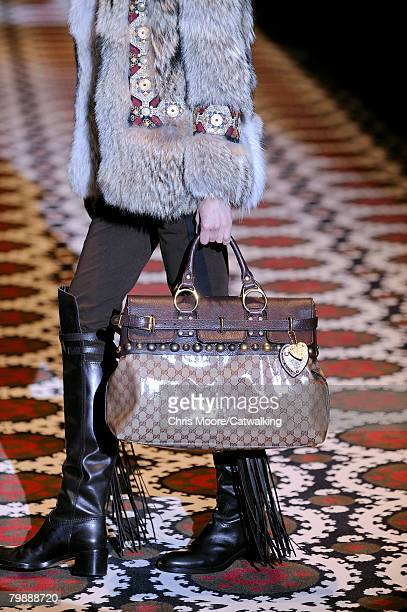 Model walks the runway carrying a bag during the Gucci Fall/Winter 2008/2009 collection during Milan Fashion Week on the 20th of February 2008 in...