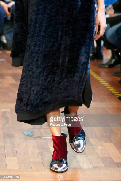 Model walks the runway clothing detail during the Rebekka Ruetz Fashion Show at Embassy of Austria on January 16 2018 in Berlin Germany