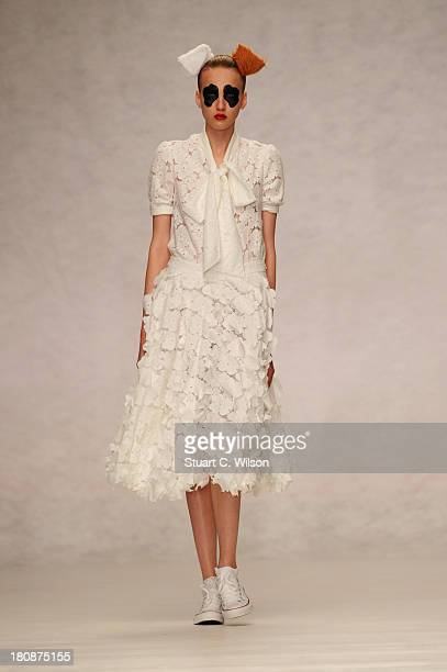 A model walks the runway displaying Ryan Lo at the Fashion East show during London Fashion Week SS14 at TopShop Show Space on September 17 2013 in...