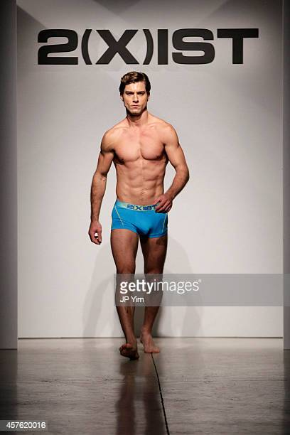 A model walks the runway during 2IST Men's Spring/Summer 2015 Runway Show on October 21 2014 in New York City