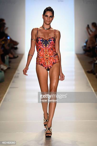 A model walks the runway during 6 Shore Road by Pooja fashion show during MercedesBenz Fashion Week Swim 2015 at Cabana Grande at The Raleigh on July...