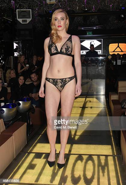 A model walks the runway during a Bluebella Lingerie show at the launch of a new collaboration between DSTRKT and FashionTV at DSTRKT on April 2 2015...