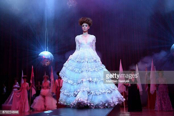 A model walks the runway during a fashion show at the Leipzig Opera Ball on November 4 2017 in Leipzig Germany