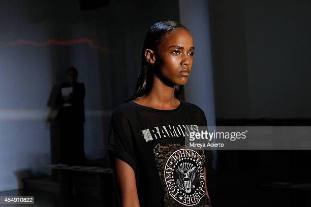 A model walks the runway during a rehearsal before the Tim Coppens runway show during MADE Fashion Week Spring 2015 at Milk Studios on September 7...