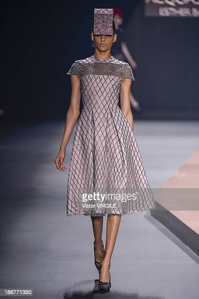 A model walks the runway during Acquastudio show at the Sao Paulo Fashion Week Winter 2014 on October 29 2013 in Sao Paulo Brazil