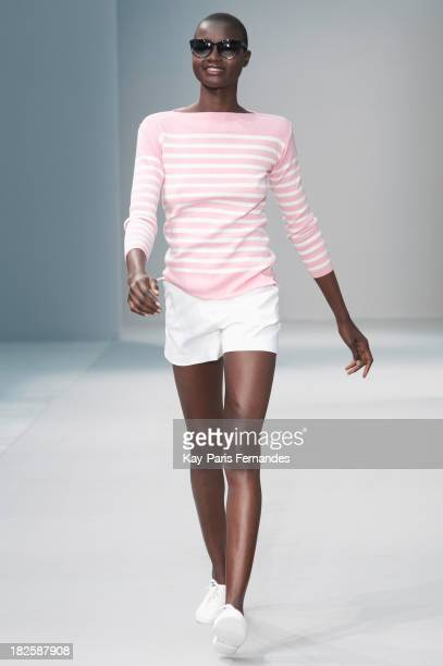 A model walks the runway during Agnes B show as part of the Paris Fashion Week Womenswear Spring/Summer 2014 at the Palais de Tokyo on October 1 2013...