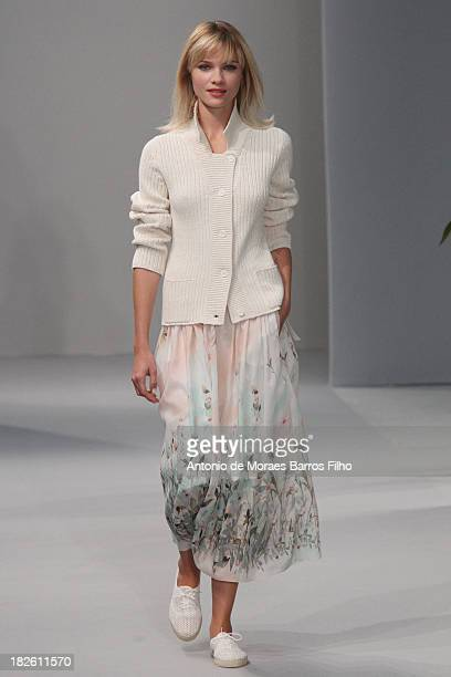 A model walks the runway during Agnes B show as part of the Paris Fashion Week Womenswear Spring/Summer 2014 on October 1 2013 in Paris France