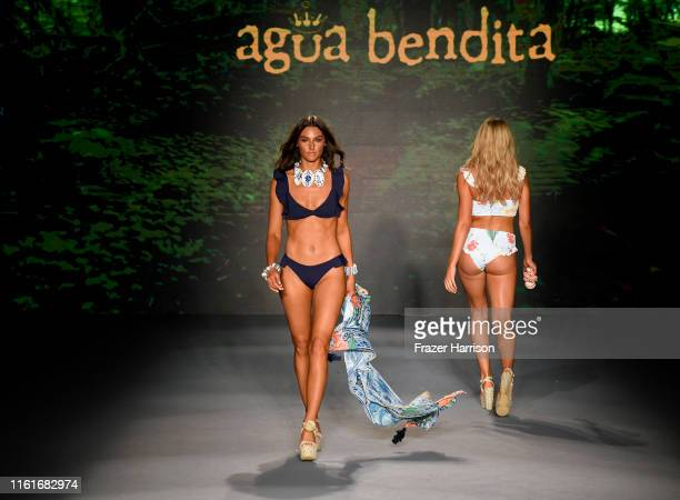 A model walks the runway during Agua Bendita X Yanbal Fashion Show at The Paraiso Tent on July 12 2019 in Miami Beach Florida