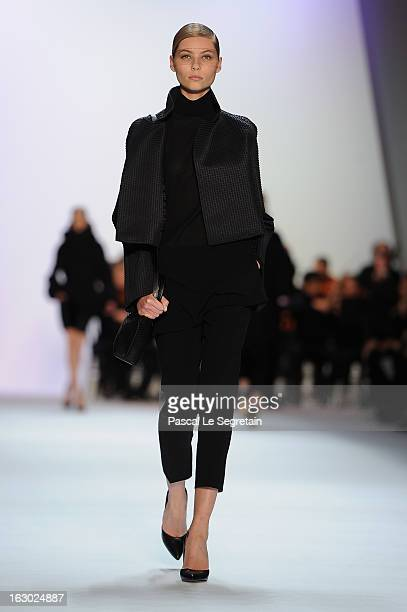 A model walks the runway during Akris Fall/Winter 2013 ReadytoWear show as part of Paris Fashion Week on March 3 2013 in Paris France