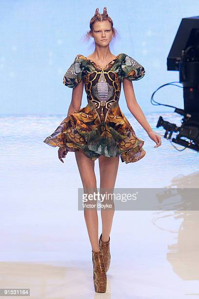 A model walks the runway during Alexander McQueen Pret a Porter show as part of the Paris Womenswear Fashion Week Spring/Summer 2010 at Palais...