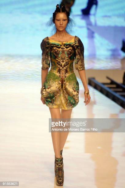 A model walks the runway during Alexander McQueen Pret a Porter show as part of the Paris Womenswear Fashion Week Spring/Summer 2010 at Palais...