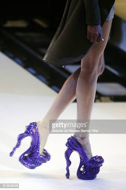 Model walks the runway during Alexander McQueen Pret a Porter show as part of the Paris Womenswear Fashion Week Spring/Summer 2010 at Palais...