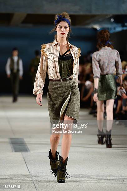 A model walks the runway during Alexis Mabille show as part of the Paris Fashion Week Womenswear Spring/Summer 2014 at Docks en Seine on September 25...