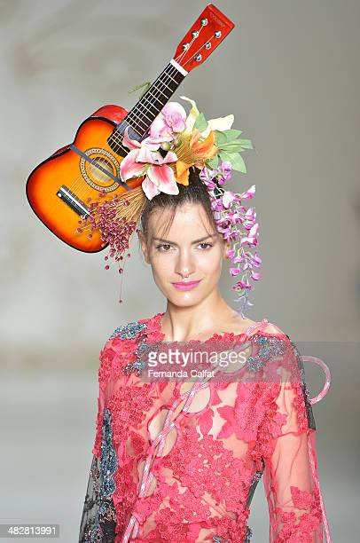 A model walks the runway during Amapo show at Sao Paulo Fashion Week Summer 2014/2015 at Parque Candido Portinari on April 4 2014 in Sao Paulo Brazil