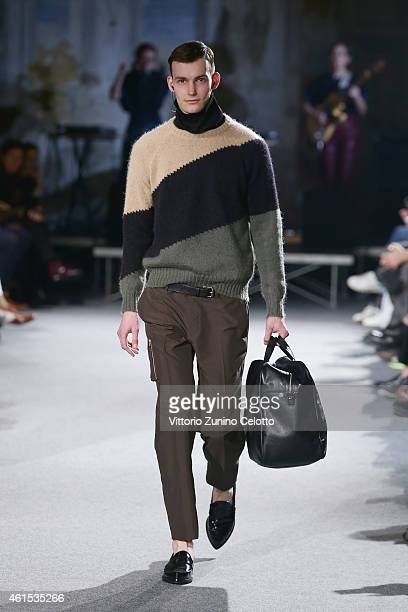 A model walks the runway during Andrea Incontri Fashion Show as a part of Pitti Immagine Uomo 87 on January 14 2015 in Florence Italy