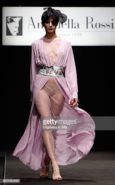A model walks the runway during Antonella Rossi S/S 2015 Italian Haute Couture colletion fashion show as part of AltaRoma AltaModa Fashion Week at...