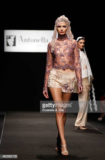 Model walks the runway during Antonella Rossi S/S 2015 Italian Haute Couture colletion fashion show as part of AltaRoma AltaModa Fashion Week at...