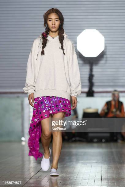 Model walks the runway during Ashish Spring/Summer 2020 collection show during London Fashion Weak in the British Fashion Council show space in...