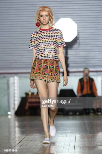 A model walks the runway during Ashish Spring/Summer 2020 collection show during London Fashion Weak in Seymour Hall in London England on the...