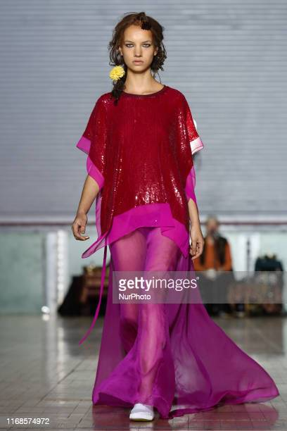 Model walks the runway during Ashish Spring/Summer 2020 collection show during London Fashion Weak in Seymour Hall in London, England on the...