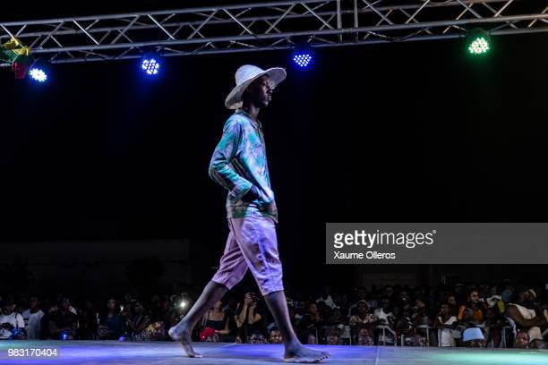 A model walks the runway during Bod'J show on last day of the Dakar Fashion Week at the working class suburb of Keur Massar on June 24 2018 in Dakar...