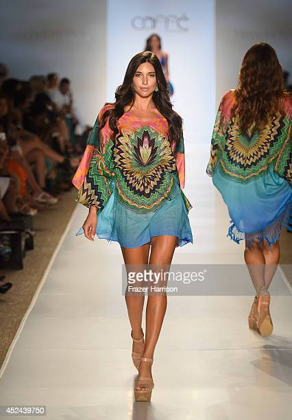 A model walks the runway during Caffe Swimwear show at MercedesBenz Fashion Week Swim 2015 at Cabana Grande at The Raleigh on July 20 2014 in Miami...