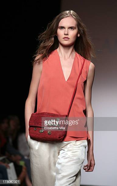 A model walks the runway during Cangiari S/S 2014 Haute Couture Handwoven ecoethical colletion fashion show as part of AltaRoma AltaModa Fashion Week...