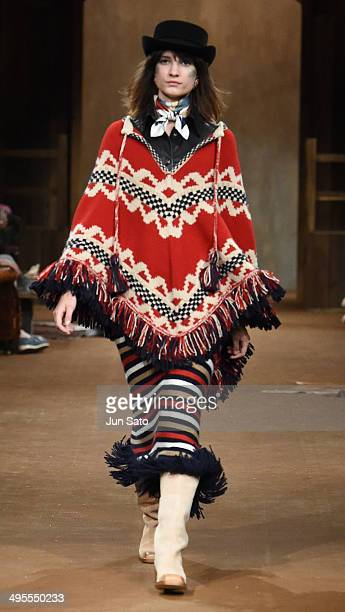 A model walks the runway during CHANEL 2013/14 'ParisDallas Metiers d'Art Collection' at Toranomon Hills on June 4 2014 in Tokyo Japan