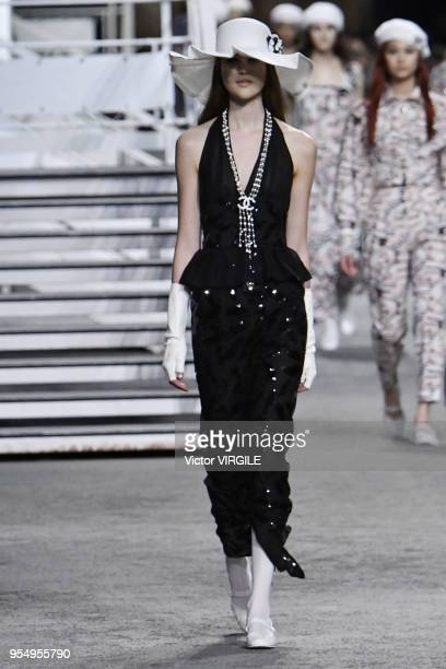A model walks the runway during Chanel Cruise 2018/2019 Collection fashion show at Le Grand Palais on May 3 2018 in Paris France