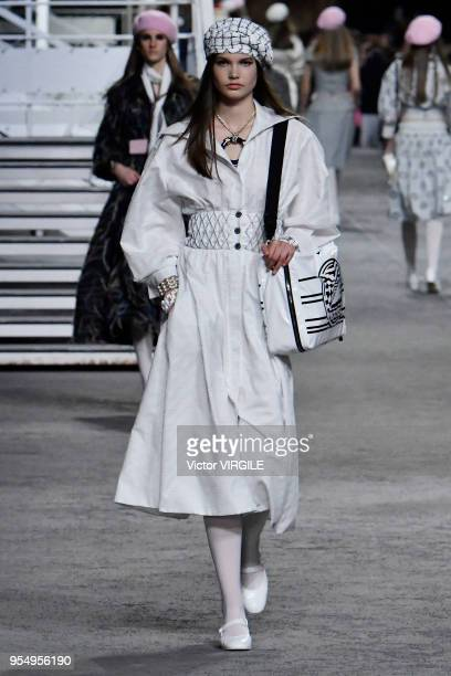 Model walks the runway during Chanel Cruise 2018/2019 Collection fashion show at Le Grand Palais on May 3, 2018 in Paris, France.