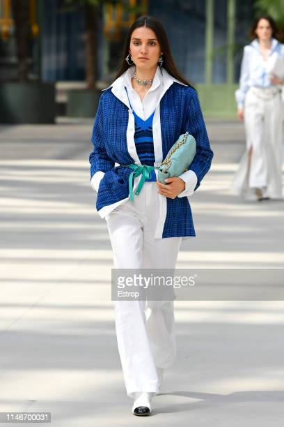 A model walks the runway during Chanel Cruise 2020 Collection at Le Grand Palais on May 3 2019 in Paris France