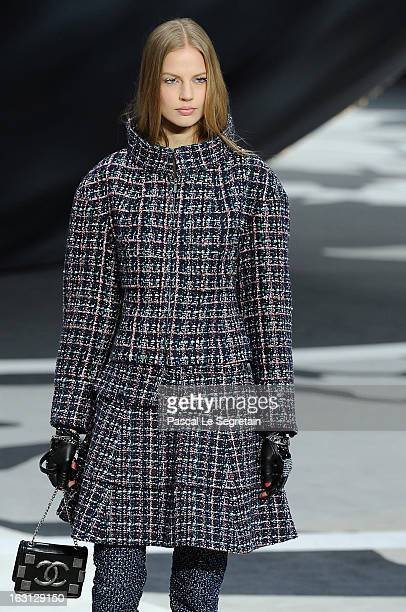 A model walks the runway during Chanel Fall/Winter 2013 ReadytoWear show as part of Paris Fashion Week at Grand Palais on March 5 2013 in Paris France