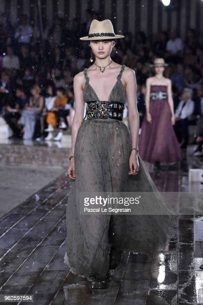 A model walks the runway during Christian Dior Couture S/S19 Cruise Collection show on May 25 2018 in Chantilly France