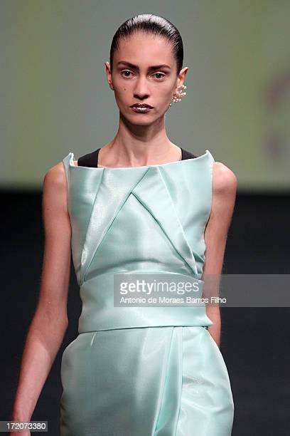 A model walks the runway during Christian Dior show as part of Paris Fashion Week HauteCouture Fall/Winter 20132014 at on July 1 2013 in Paris France