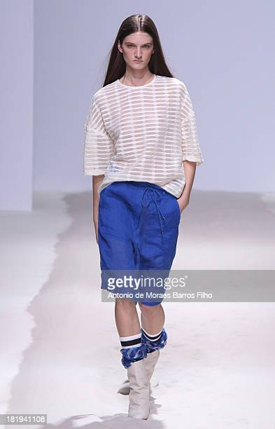 Model walks the runway during Christian Wijnants show as part of the Paris Fashion Week Womenswear Spring/Summer 2014 on September 26, 2013 in Paris,...
